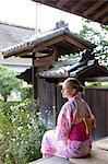 Caucasian woman wearing yukata in traditional Japanese house