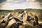 Iron ore opencast mining landscape on summer sunset