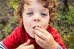 Portrait of boy eating grapes in vineyard