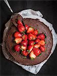 Paleo (floverless and gluten free) chocolate cake with strawberries