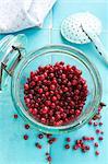 Lingonberries in a flip-top preserving jar
