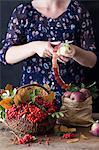 woman peeling apple