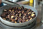 Street vendor roasting chestnuts
