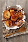 Roasted caramelised pears with cinnamon sticks