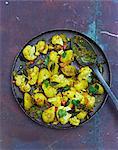 Allo ghobi (cauliflower curry with potatoes, India)