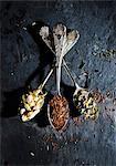 Various types of tea on three vintage spoons