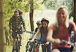 Family mountain biking in woods