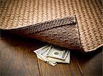 Money hidden under rug
