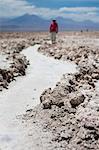 Person walking along path in sand in desert, San Pedro de Atacama, Chile