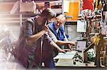 Motorcycle mechanics working in workshop