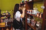 Woman selecting sweet box in shop