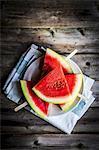 Watermelon slices on sticks