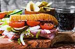 Ham, gherkin and tomato sandwich
