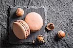 Hazelnut macaroons on a black stone