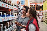 Saleswoman assisting female customer in hardware store