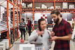 Salesman assisting female customer in hardware store