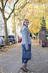 Pretty elegant woman walking with handbag in citycenter