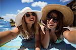Happy women taking sunbath on a sunny day