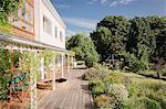 Home showcase luxury villa with sunny summer garden and deck