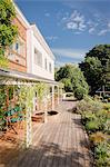 Sunny home showcase exterior villa with patio and garden