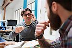 Design team brainstorming at design studio desk meeting