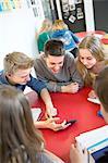 Teenagers looking at smartphone