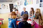 Teenagers talking in classroom