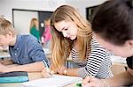 Teenage girl studying in classroom