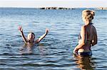 Boy splashing in lake