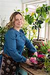 Woman planting flowers in winter garden