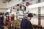 Mechanic working in garage