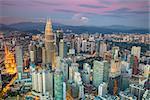 Cityscape image of Kuala Lumpur, Malaysia during sunset.