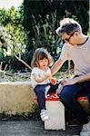 Father and little girl enjoying orange