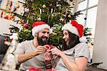 Couple exchanging gift on Christmas
