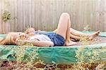 Girls lying down on trampoline