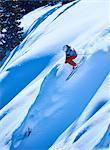Man skiing down steep mountainside, Aspen, Colorado, USA