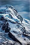 Snow covered mountain top of the Pennine Alps at Zermatt in Switzerland