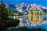 Grand Hotel Misurina and mountains reflected in Lake Misurina in the Dolomites near Cortina d'Ampezzo, Italy