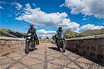 Motorbikes driving over a bridge of the Urubamba River, Chocosillane Pucara, Cusco, Peru, South America