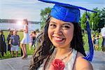 Portrait of teenage girl wearing graduation cap