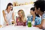 Friends having drinks together in cafe