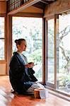 Caucasian woman wearing yukata at traditional ryokan, Tokyo, Japan