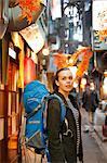 Caucasian backpacker downtown Tokyo at night, Tokyo, Japan