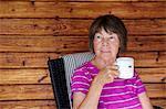 Senior woman having drink