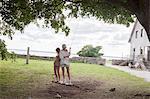 Teenage girls swinging
