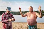 Senior men at lake