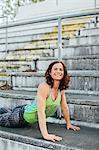 Woman training on stadium benches