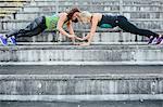 Women training on stadium benches