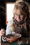 Mature woman having soup