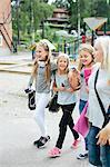 Happy girls walking together